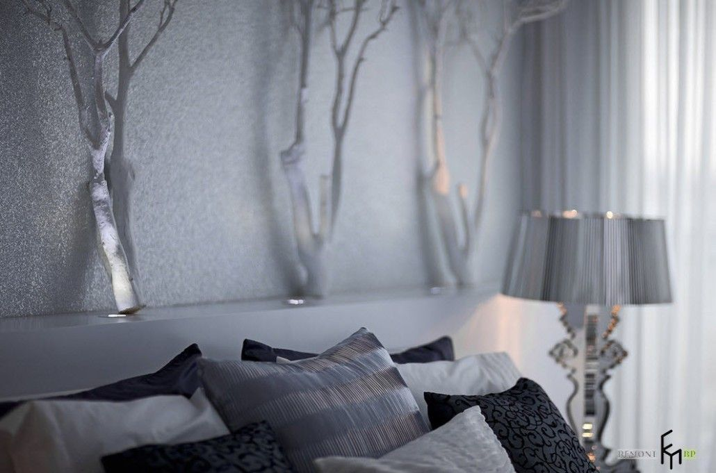 Unusual headboard decoration in the form of winter forest trees