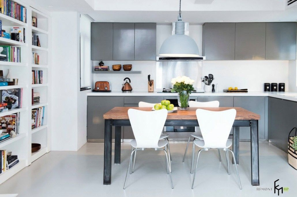 Gray steel and dark gray furniture set and white chairs in the modern kitchen