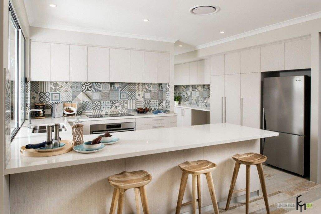 White milky surfaces and Moroccan tiles at the backsplash