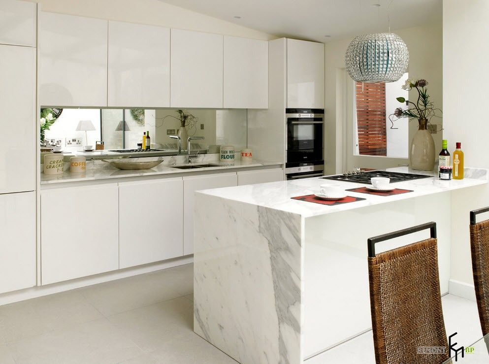 Gorgeous kitchen interior design with white glossy idyll