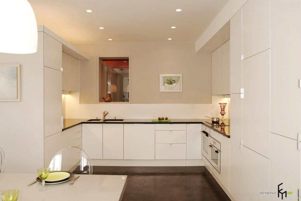 Beautifully designed white glossy kitchen with two-row built-in fixtures