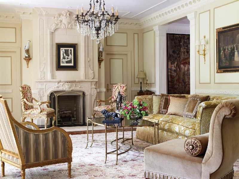 Restrained chic stucco and moldings in light Classic Italian living with fireplace