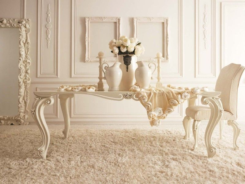 Milky color theme for the living room with fretwork and figured table