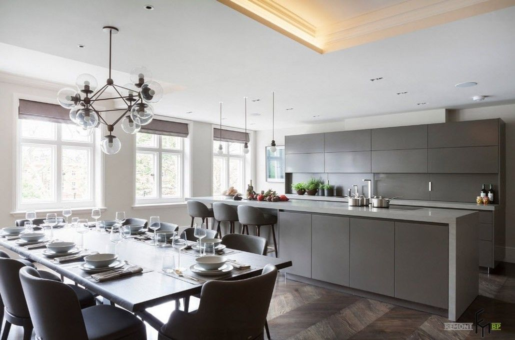 Classic and modern intermixing in large gray colored kitchen