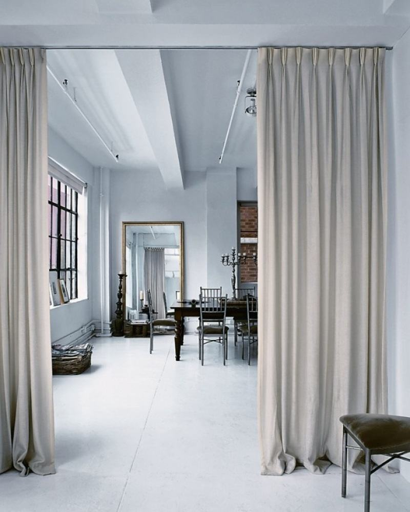 Long coffee colored curtains to separate studio apartment