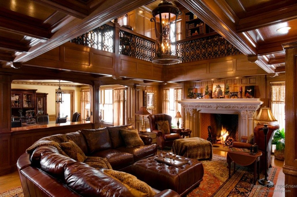 Spectacular high two-level room with mezzanine floor full of leather and wooden element