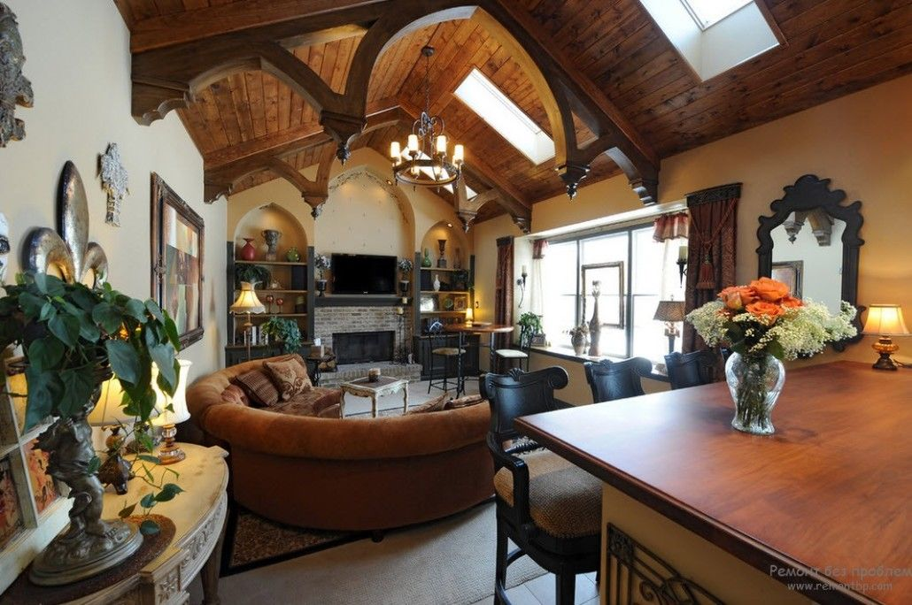 Wooden arched ceiling and the rounded large sofa for the living open layout room