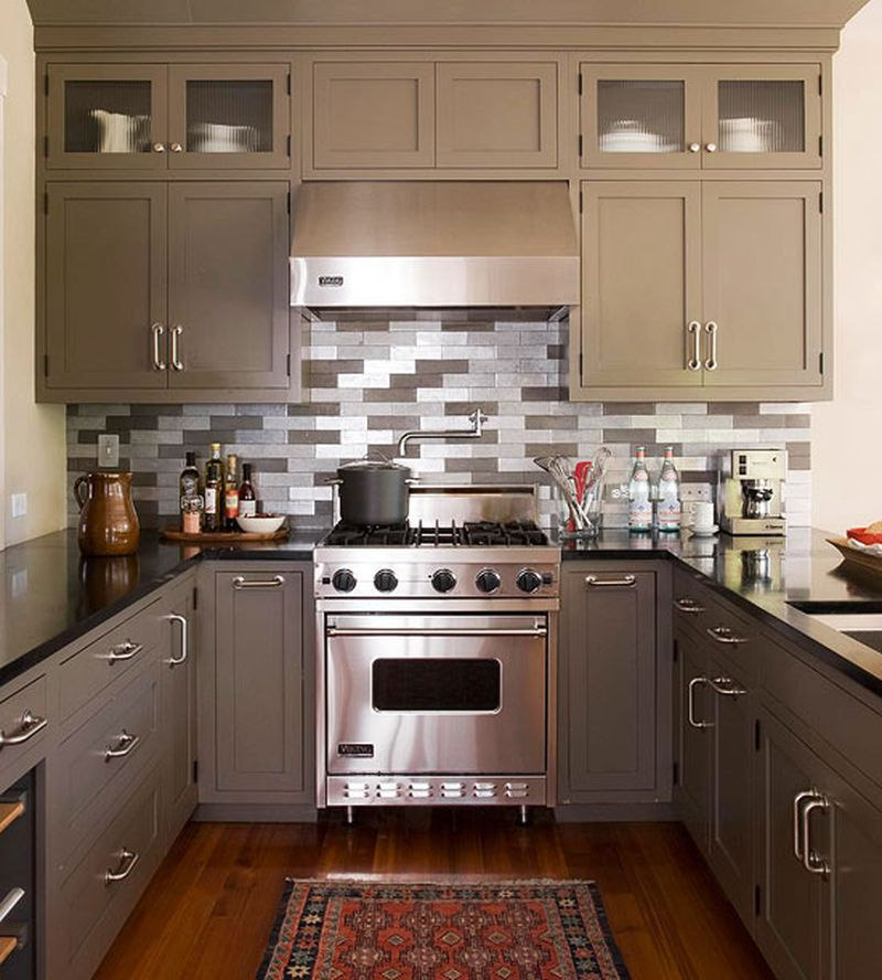 Gray classic styled kitchen with unusual lined backsplash