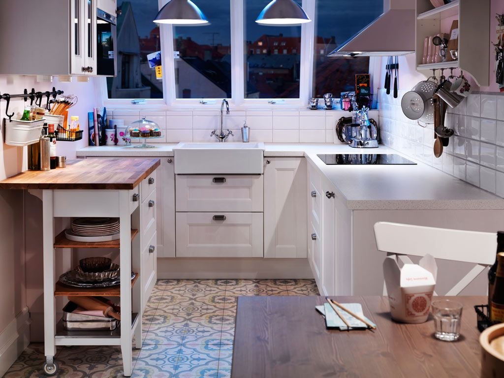 Nigh sight at the white color decorated Casual styled small kitchen