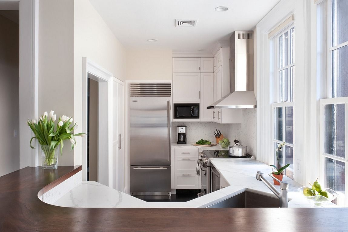 Contemporary gray space with sparkling steel hood and fridge