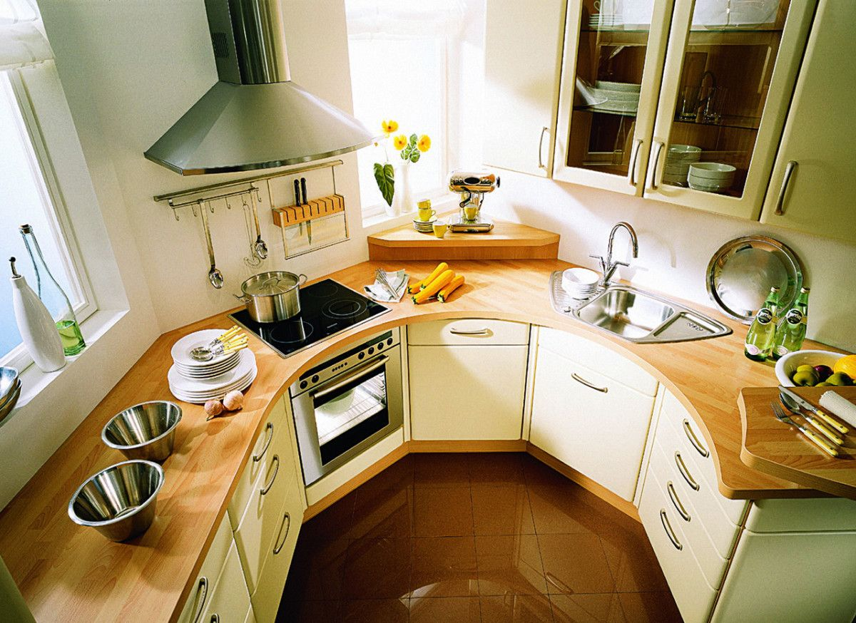 Unusual u-shaped variant of the layout at the light decorated kitchen