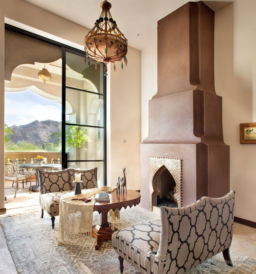 Mediterranean accent in the form of high fireplace at the living room