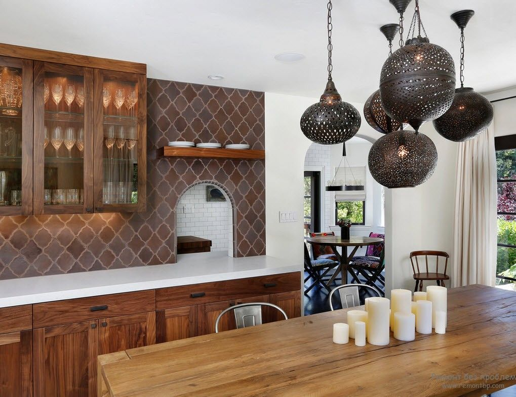 Metal lampshades and Moroccan pattern of the backsplash at the kitchen