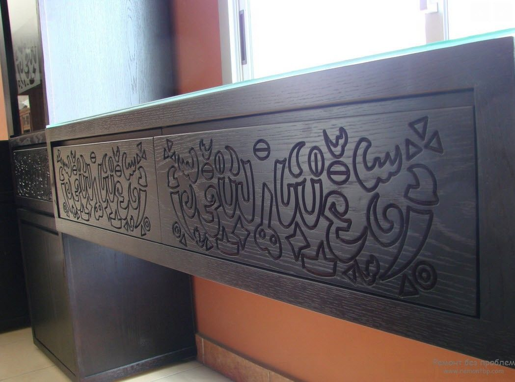 Wooden carvings of Quran phrases as the decoration of interior