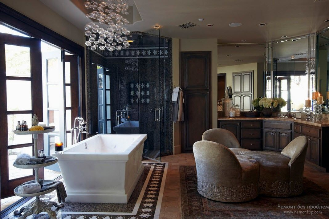 Luxurious designed master bathroom with open space layout and entrance to the patio