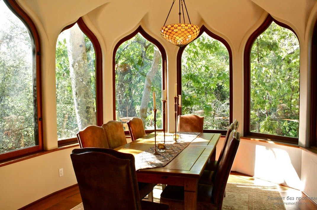 Oriental styled sunroom with plenty of arched windows