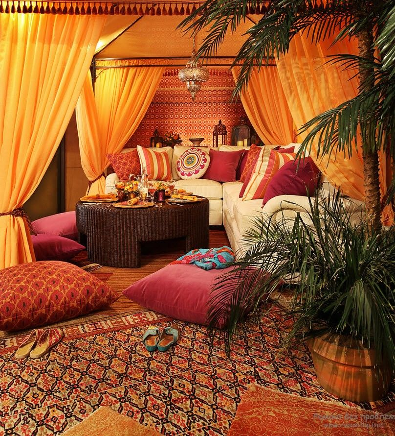 Tent looking living zone in orange and burgundy color play