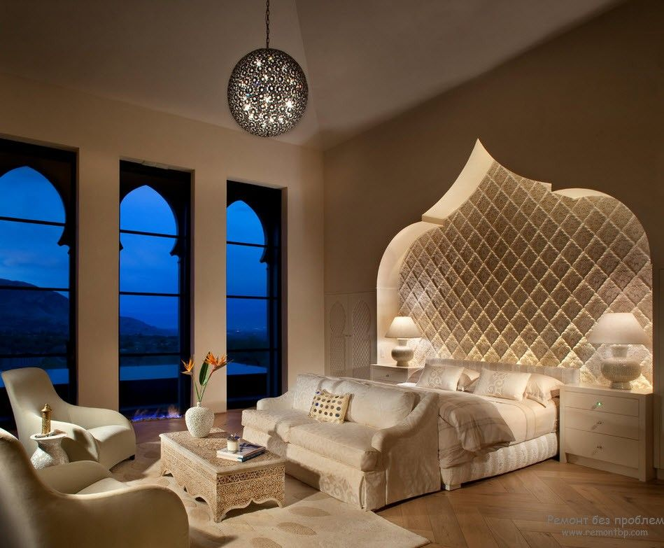 Domed and highlighted headboard at the spacious bedroom
