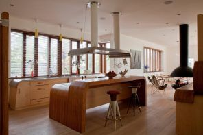 Spectacular arched wooden laminated kitchen island at the center