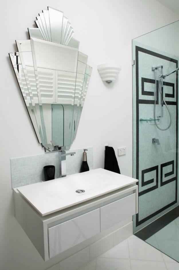 Modern styled bathroom with unusually formed mirror