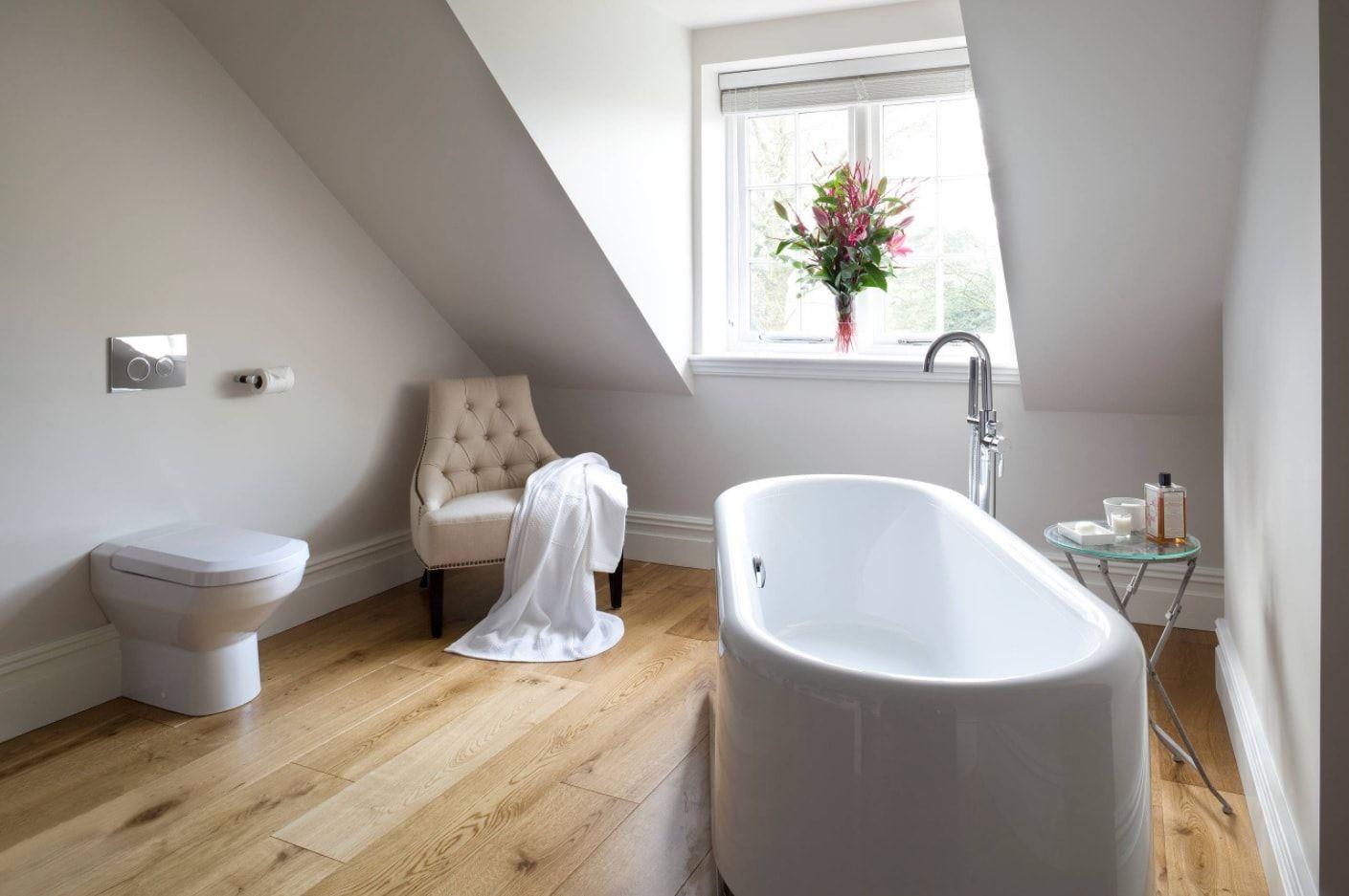 Modern and Loft designed bathroom with white stone oval bathtub