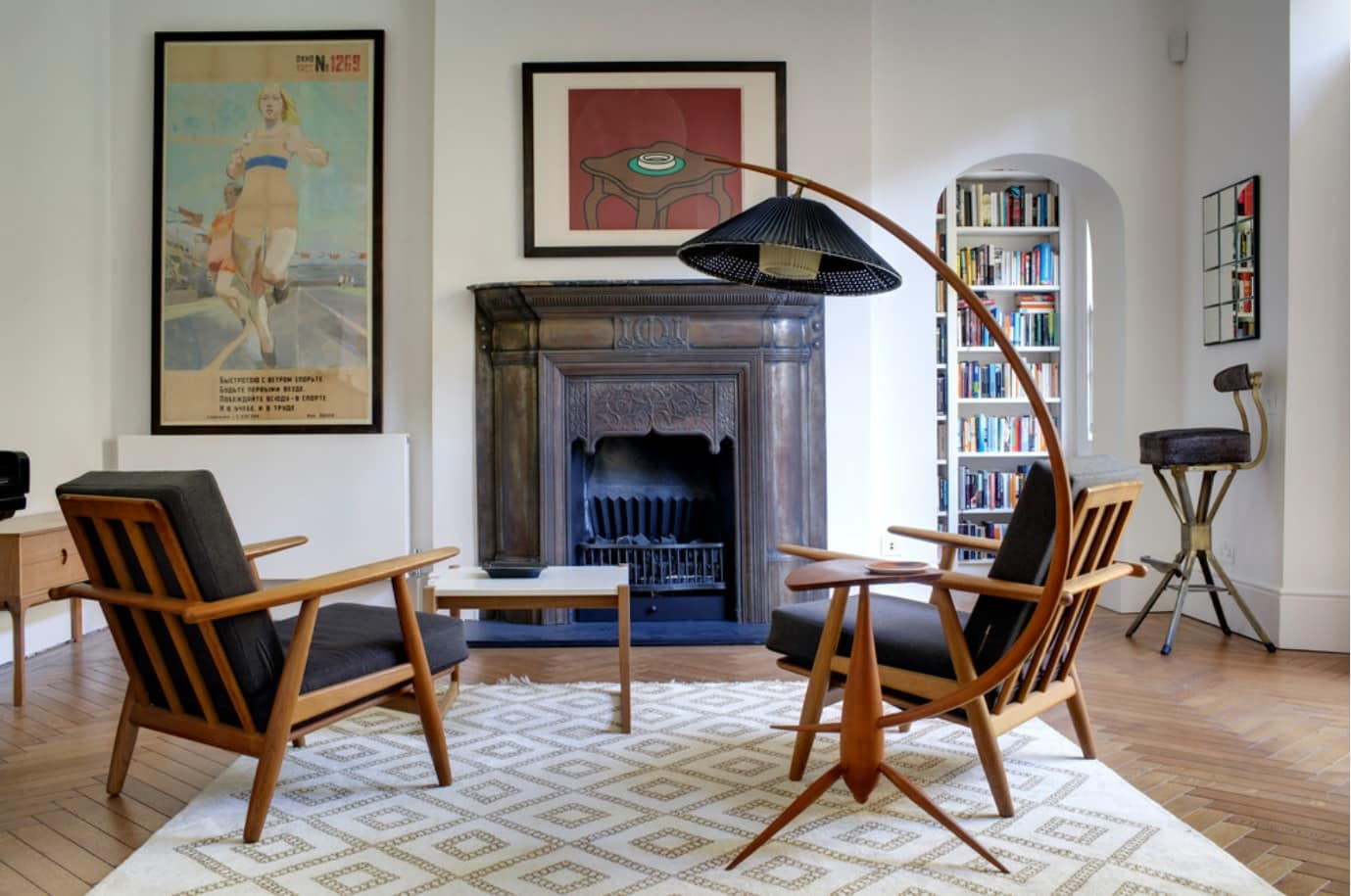 Classic setting of the room with black upholstered furniture on natural wooden frames and with large lamp all over the living zone