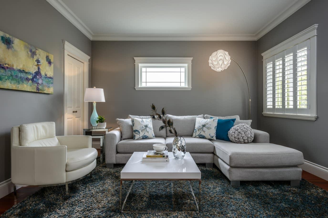 Gray classic room theme with angular upholstered sofa