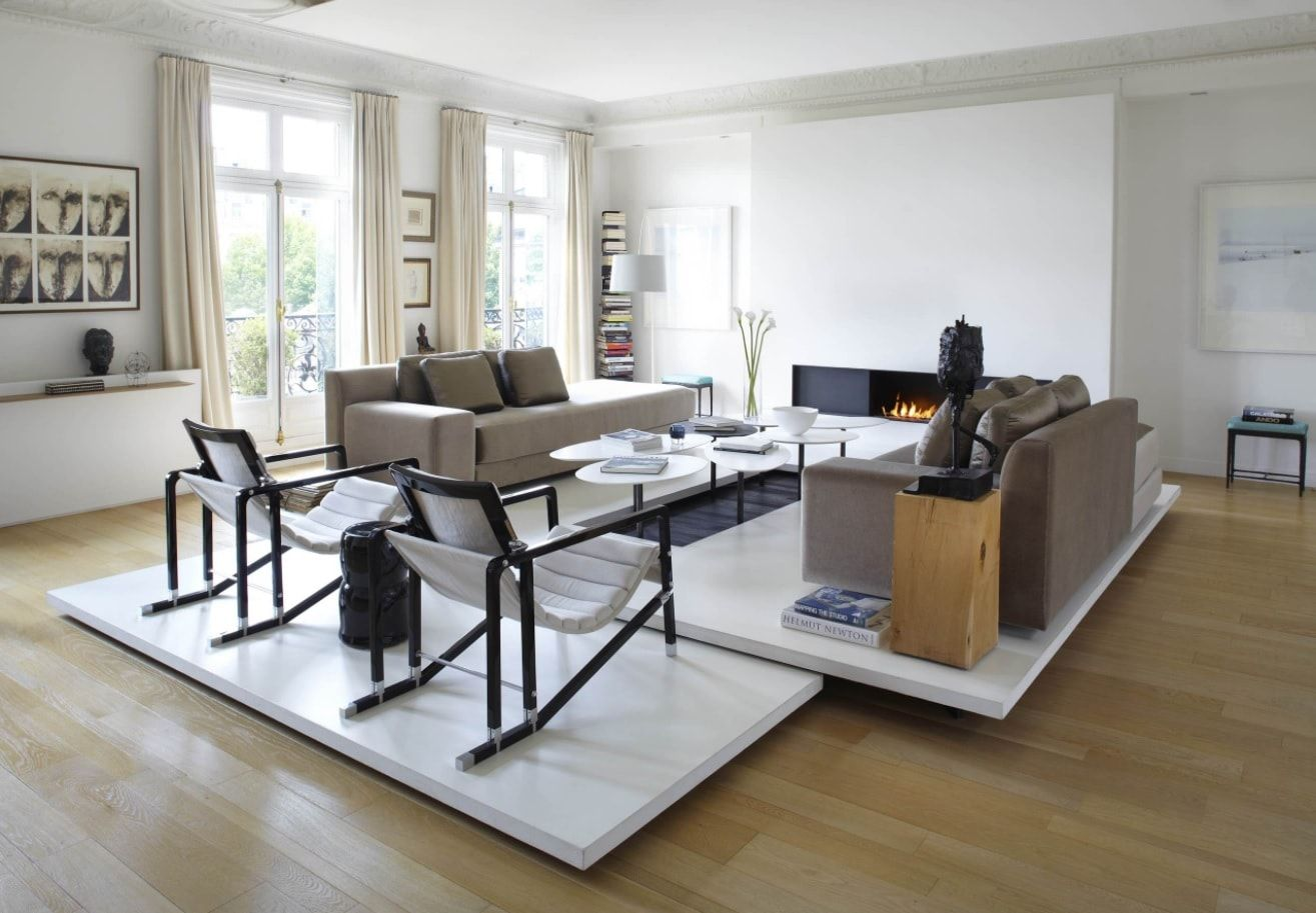 White and gray classic setting of the large open layout room with modular upholstered furniture
