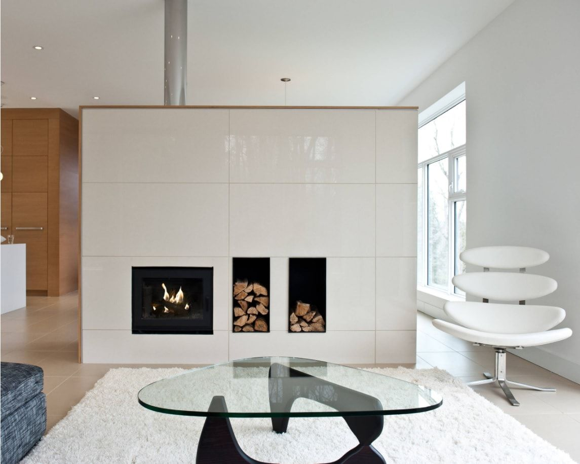 Round glass table on original formed legs in the Scandi style minimalistic room