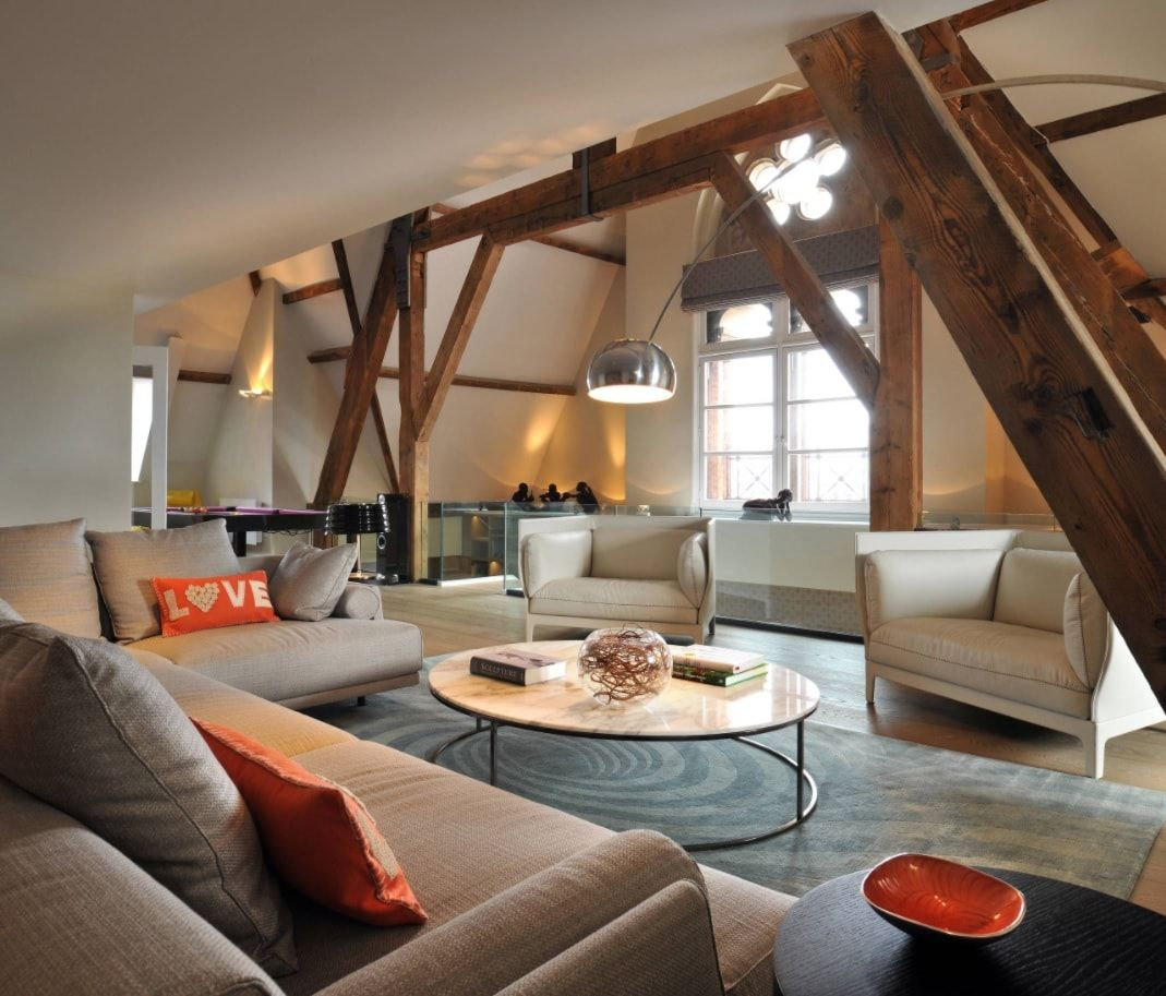 Industrial styled room with open ceiling beams and scaffolds right in the room