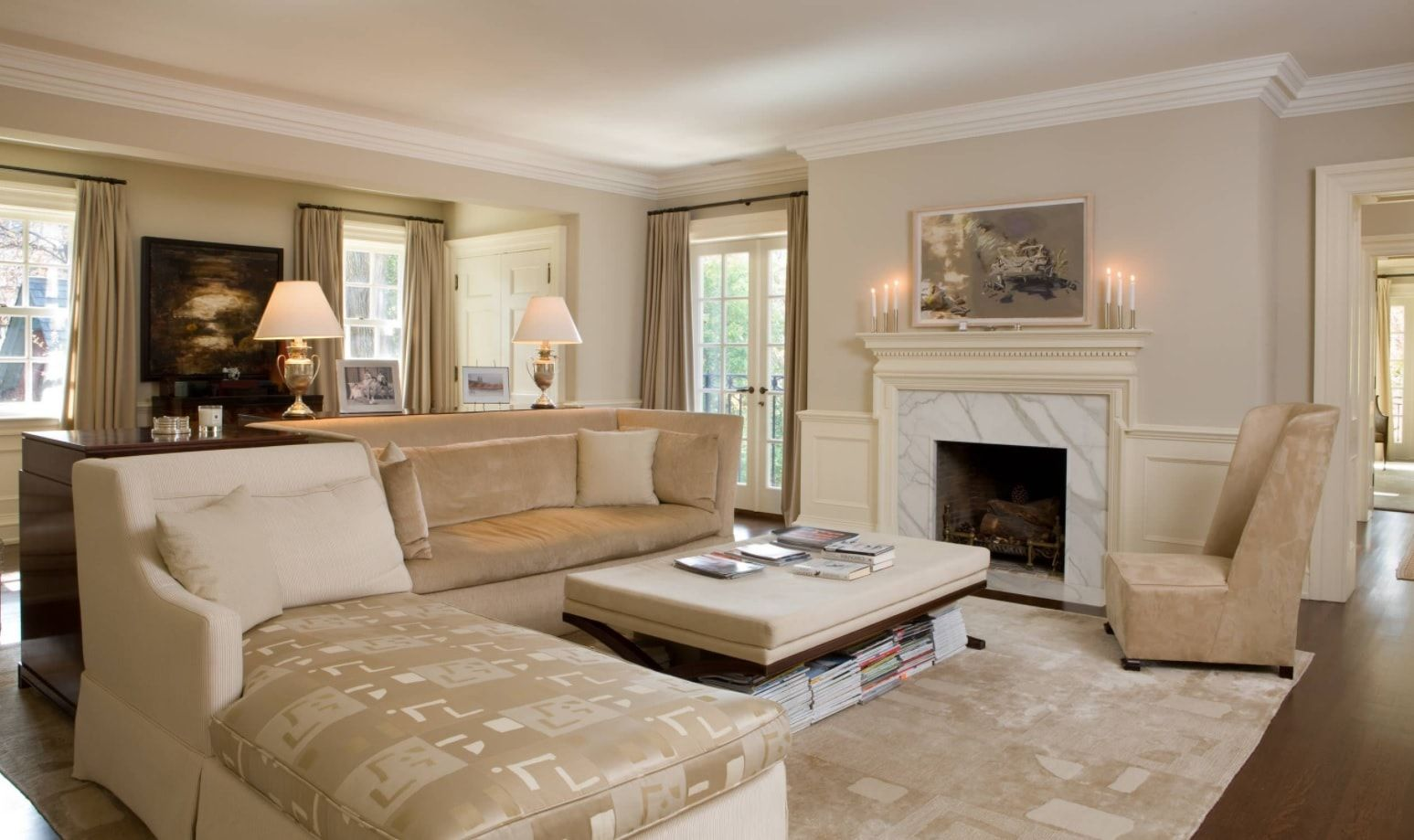 Classic styled gray room with ottoman and fireplace