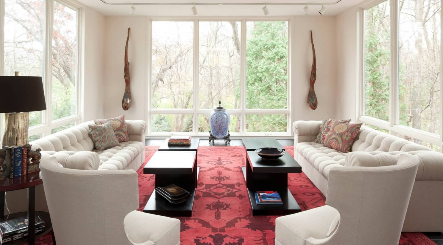 Classic setting of the large and light sitting room with two coffee tables and passage between them
