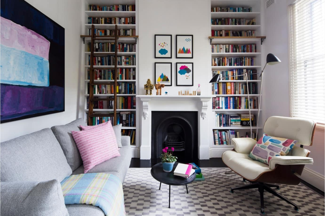Library type of the living room with high ceiling, bookshelves and soft zone