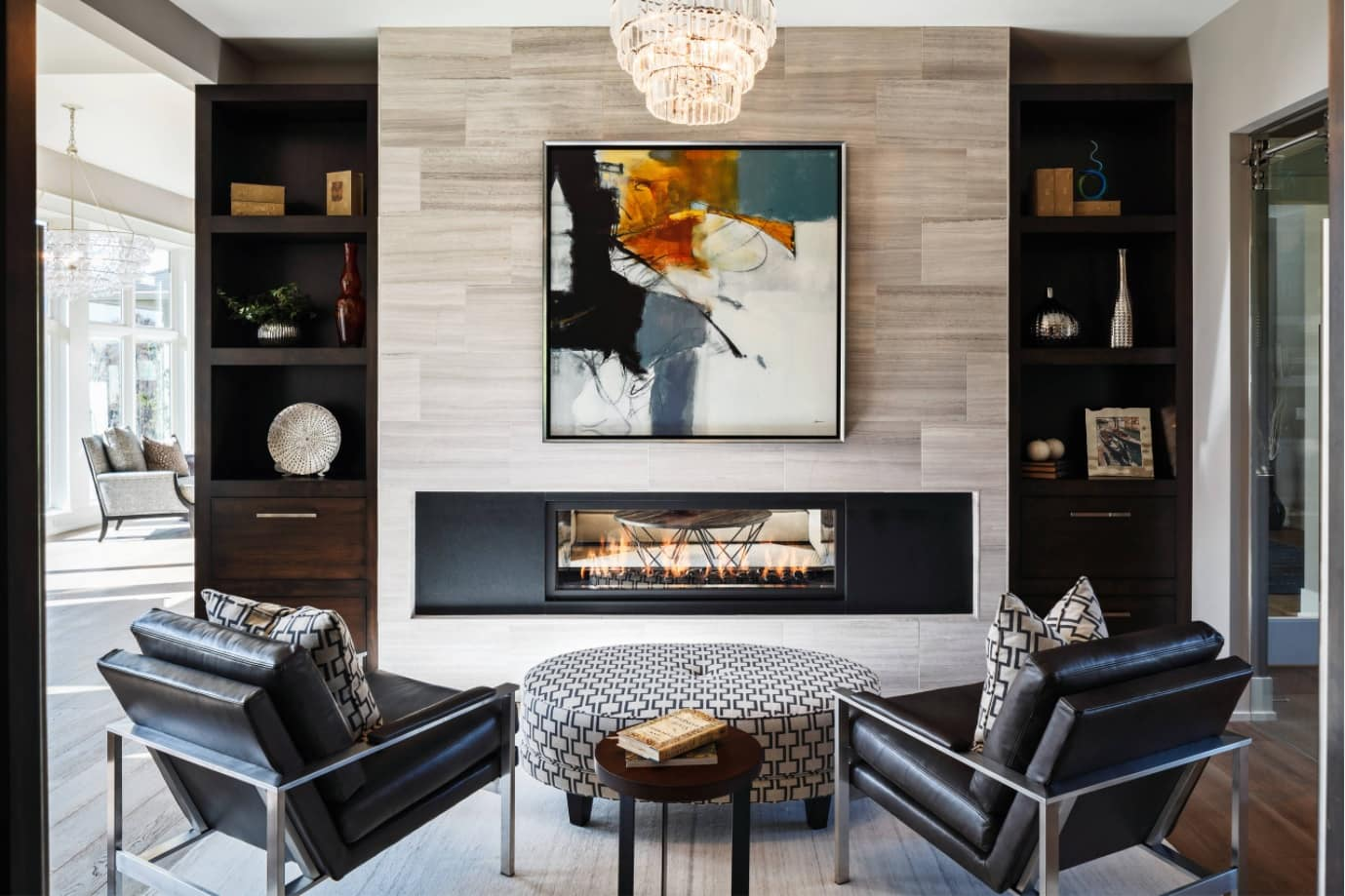 Modern English interior with fireplace, dark chairs and accent wall