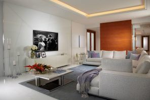 Light gray toned modern living room with wooden panelled accent wall