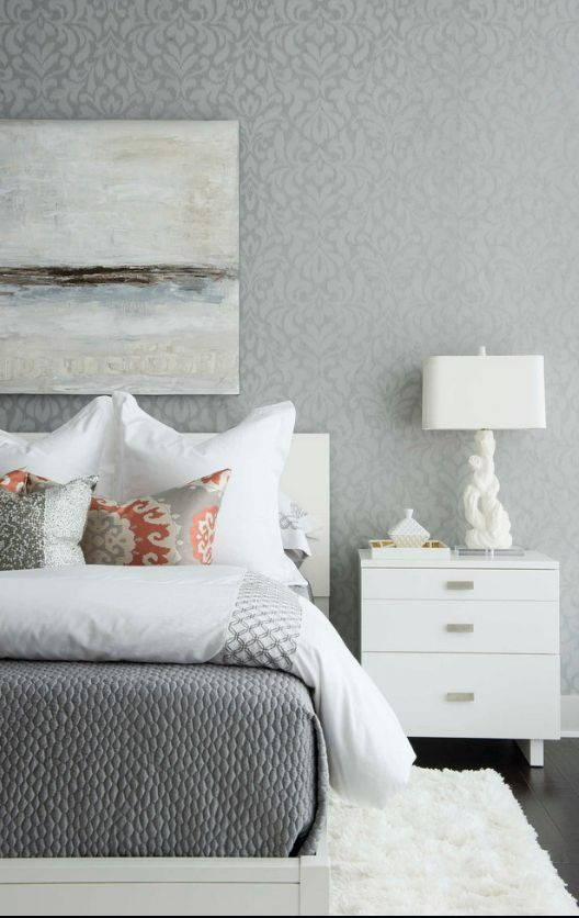 Gray walls and white furniture for the bedroom with panel above the head of the bed