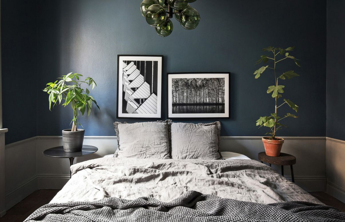 Dark blue wall and large bed for the Casual eco style of the small bedroom
