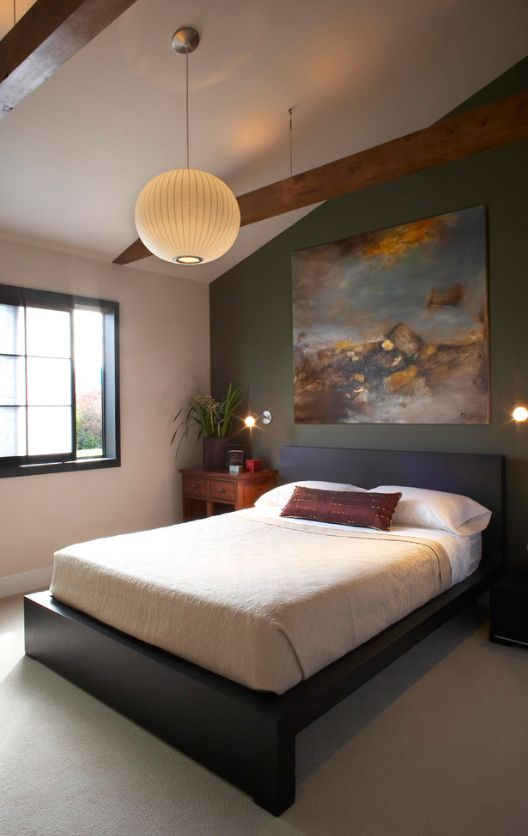 Wet asphalt colored accent wall with the large picture in the Loft styled bedroom
