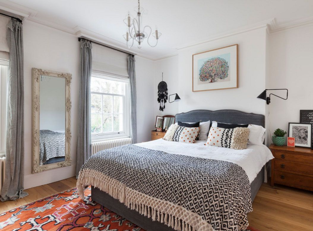 Classic design in the room with gray curtains and coverlet