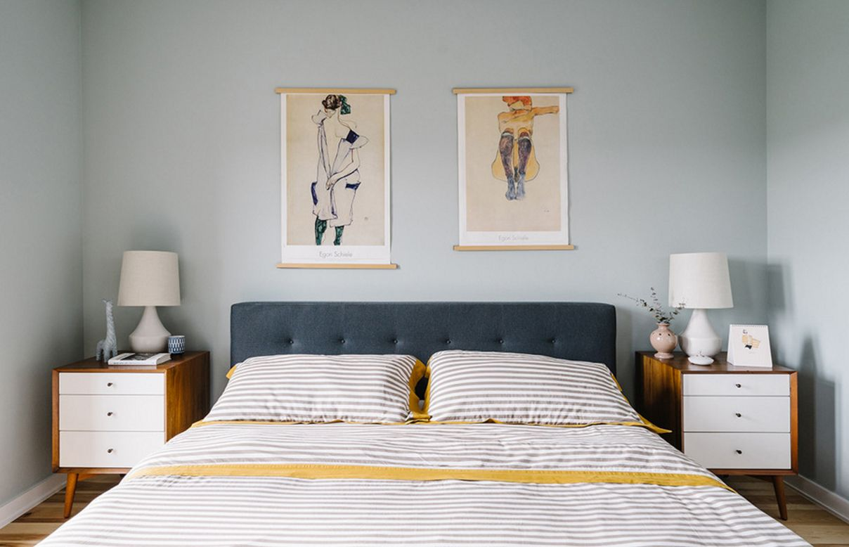Light blue walls and quilted headboard
