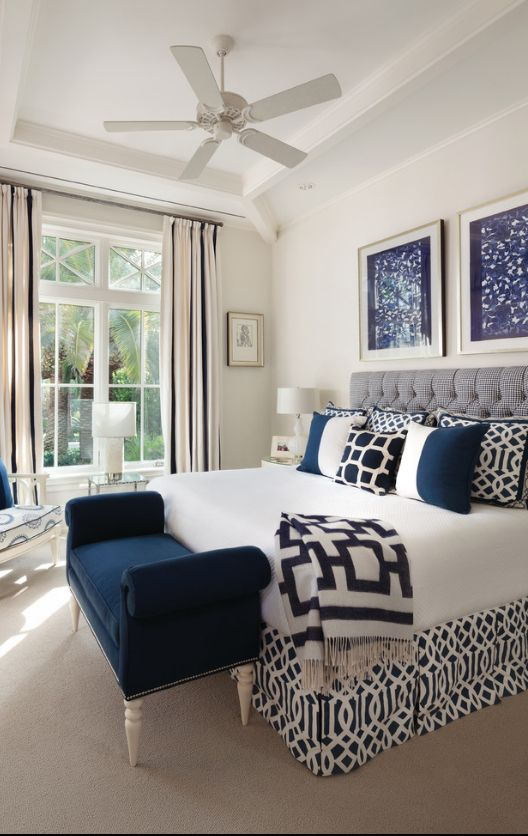 Open layout master bedroom with the balcony and dark blue ottoman