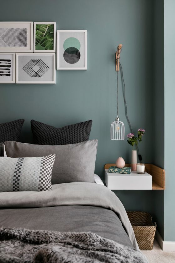 Dark green wall paint in the Casual styled bedroom with collage of pictures