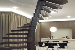 Modern complicated constructed spiral staircase for the cute minimalistic design of the apartment