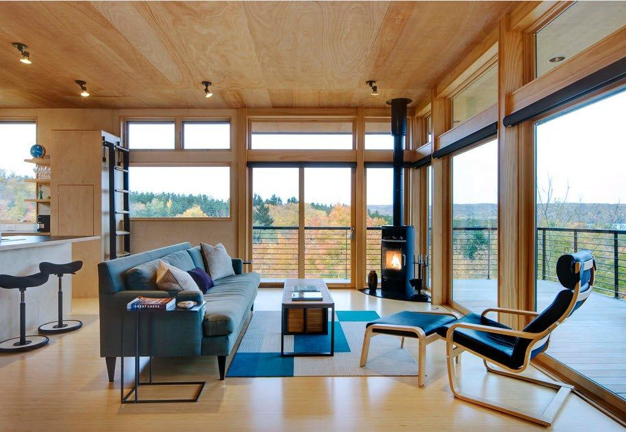 Light wooden finishing for modern cottage with upholstered furniture