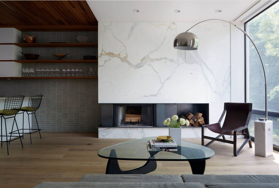 Modern living room with glass coffee table and artificial fireplace