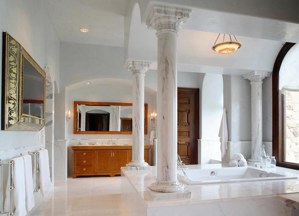 Sophisticated Luxury and Refinement. Antique marble columns for chic bathroom
