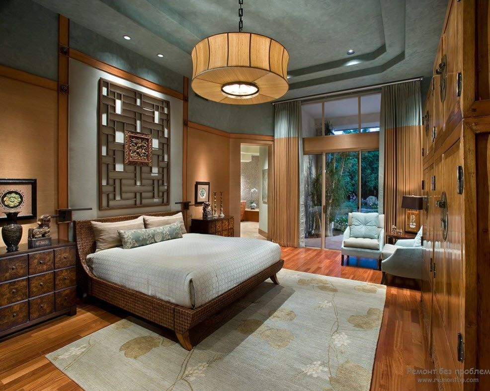 Modern decorate bedroom with oriental tradition in form of paperworked chandelier