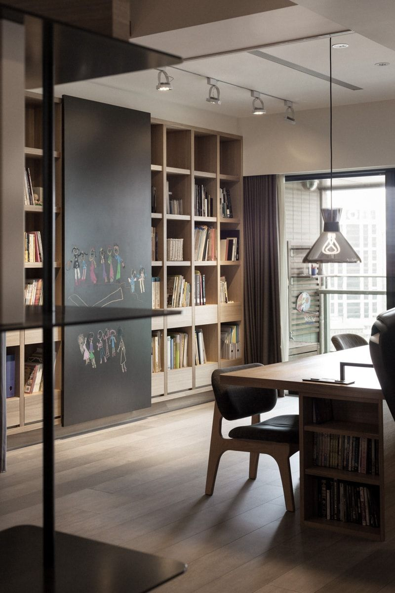 Dark wood and modern dining room with library and relaxing zone