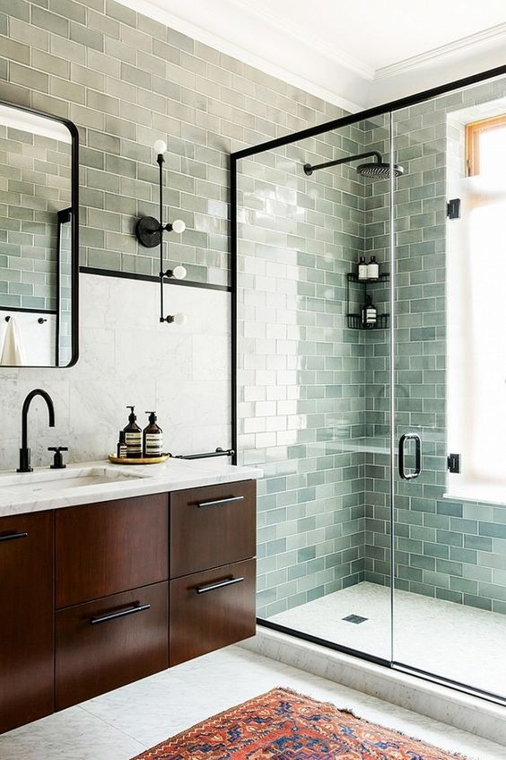 Bluish subway tile in the frameless shower cabin