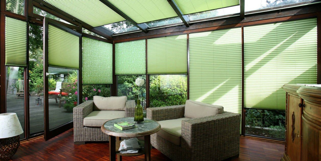 Green pleated curtains at the sunroom